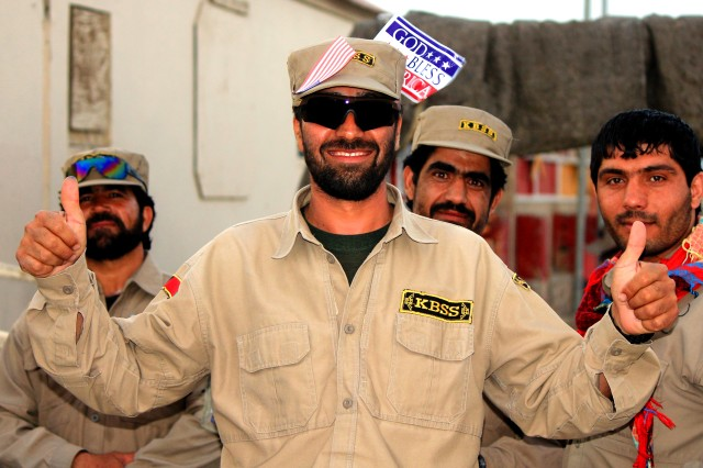 """PAKTIKA PROVINCE, Afghanistan """" A group of contractors enjoy the festivities during Freedom Fest at Forward Operating Base Sharana, Afghanistan, July 7, 2013. Soldiers and civilians assigned to the post celebrated Independence Day with carnival games, a barbecue and music"""