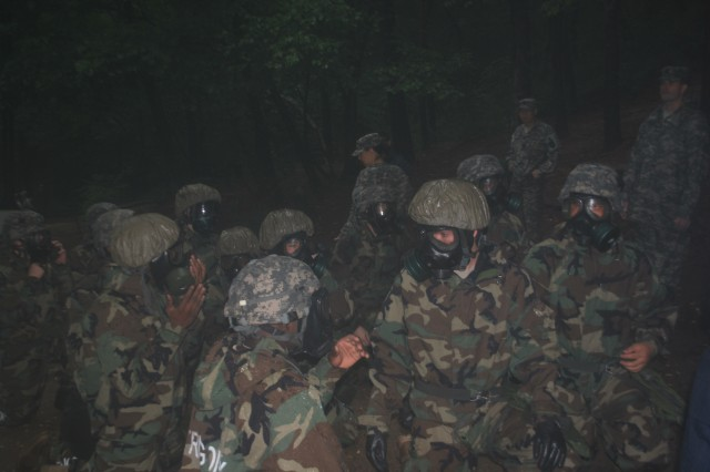 Soldiers from the 41st Signal Battalion, 1st Signal Brigade, together with Solders of Republic of Korean Army 60th Signal Battalion, prepares to enter the gas chamber for NBC training during the ROKA guerilla training in Guri City, South Korea July 2, 2013.