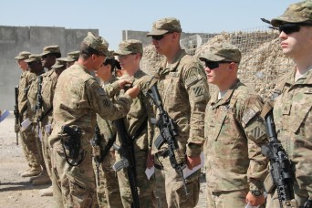 Thirty-two 'Mustang' soldiers from Headquarters and Headquarters Troop, 6th Squadron, 8th Cavalry Regiment, 4th Infantry Brigade Combat Team, 3rd Infantry Division, were awarded combat badges, July 6, during an awards ceremony held on Forward Operati...
