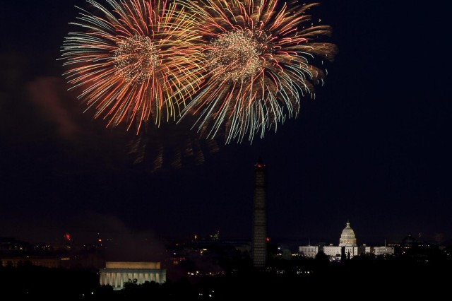 Viewed from Whipple Field on Joint Base Myer-Henderson Hall, fireworks explode over the Washington, D.C. skyline for Independence Day July 4, 2013.
