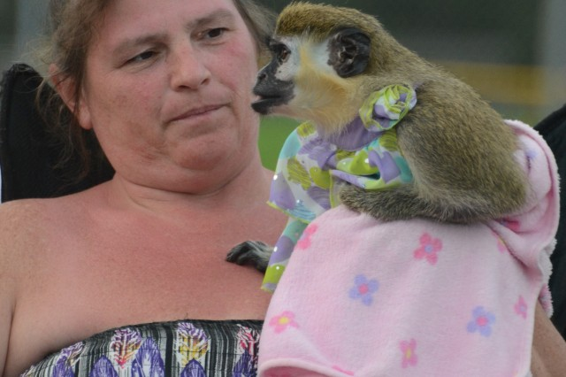 Sandy Ketcham shows off her pet monkey Kikki at the festivities.