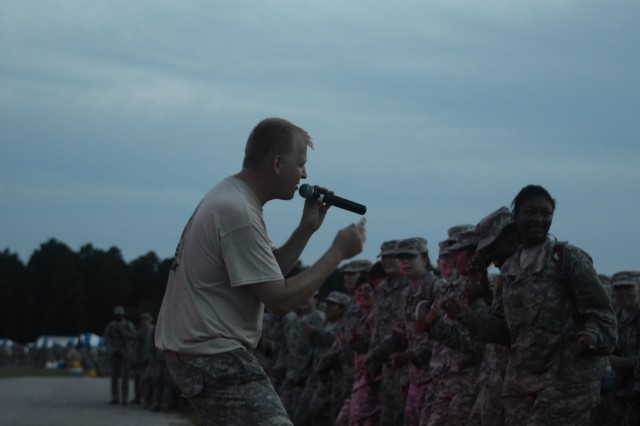 A Soldier with the 282nd Army Band's rock group entertains the crowd.