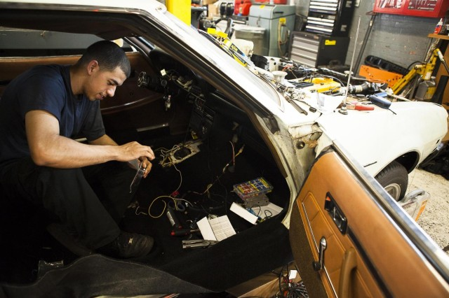 Staff Sgt. Jose Gonzalez, from a National Guard air defense unit based out of Joint Base Anacostia-Bolling, works on his 1975 Toyota Celica in the Joint Base Myer-Henderson Hall auto shop June 26, 2013.