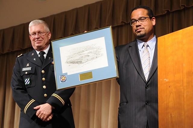 Pentagon Chaplain Col. Thomas Waynick presented Minnesota Representative Keith Ellison with a gift, on behalf of the Pentagon Muslim community, at the Pentagon, July 11, 2013.