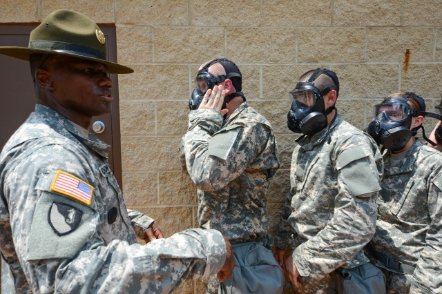 Drill Sergeant Garus Richardson assigned to E Company 3rd Battalion 10th Infantry Regiment instructs Basic Combat Training Soldiers to enter the gas chamber on July 8, 2013 on Fort Leonard Wood MO. The Soldiers are exposed to CS gas to build confidence in their M50 series gas mask. (U.S. Army photo by Staff Sgt. Ronald Shaw Jr.)(Released)