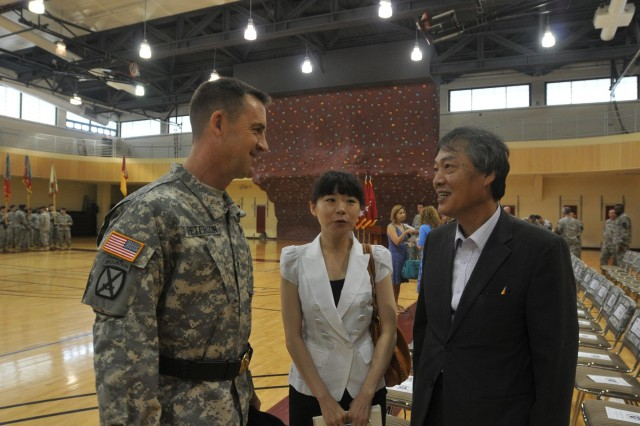 Brig. Gen. Erik Peterson, the 2nd Infantry Division's new deputy commanding general for support, talks with Pyeongtaek Vice-Mayor Oh, Teak-Yeong through his interpreter at a ceremony July 16 at Camp Humphreys. Peterson previously served at Camp Humphreys as a helicopter pilot in 1987 during his first assignment in the Army.