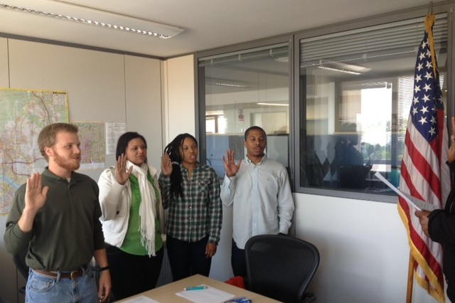 University students, from left, Michael Gray-Lewis, Yillian Rivera, Tiffany Williams and Donatello Barrett take the civilian service oath of office June 3 in Wiesbaden, Germany, as the Advancing Minorities' Interest in Engineering partnership with U.S. Army Corps of Engineers kicked off its 17th year at Europe District.