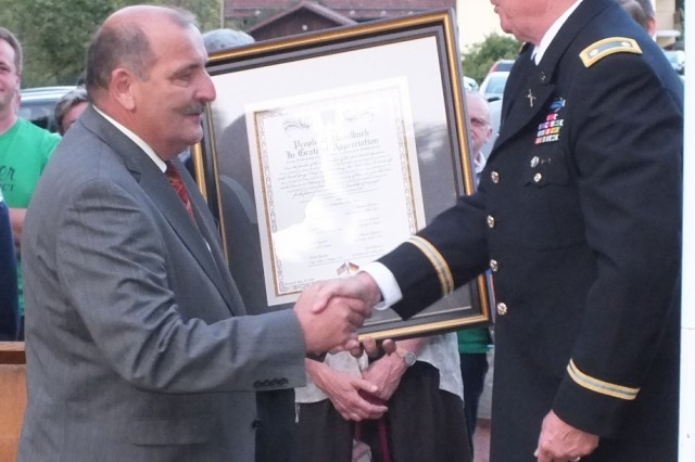 Retired Army Lt. Col. Ed Sherwood presents a certificate of appreciation to Haselbach Mayor Johann Sykora on behalf of the crash victims' families.