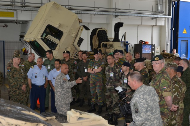 Master Sergeant Wilfredo, 317th Maintenance Support Company, explains to 33 delegates from Conventional Forces Europe Treaty Compliance countries who visited Baumholder June 26 what Soldiers do on a day to day basis in a motor pool. The delegates also received information from U.S. Army Garrison Baumholder personnel about how Soldiers, Family members and Civilians live, work and play on a U.S. military installation.