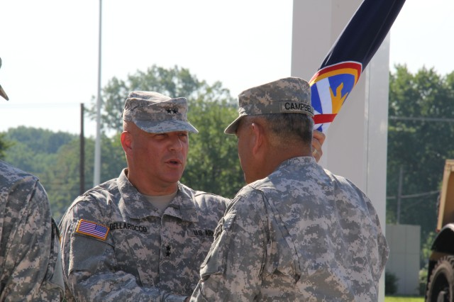 Maj. Gen. Genaro J. Dellarocco shares a few words with Vice Chief of Staff of the Army Gen. John F. Campbell as he passes the unit colors signifying the end of his command at the U.S. Army Test and Evaluation Command in a ceremony at Aberdeen Proving Ground, Md., July 16, 2013.