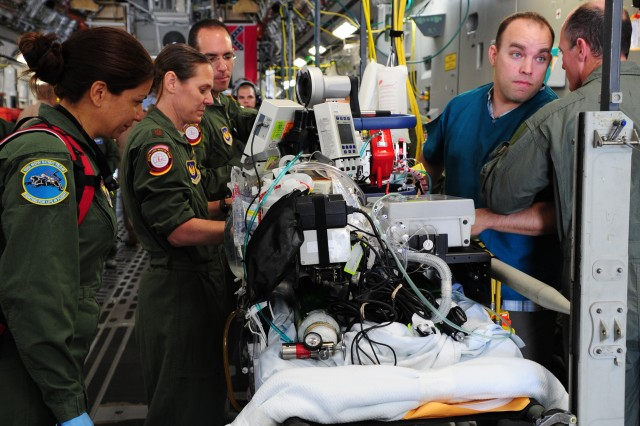A specialized medical team ensures a patient is safe and ready for takeoff July 10, 2013, at Ramstein Air Base, Germany. A team of Brooke Army Medical Center doctors and nurses treated the patient with extracorporeal membrane oxygenation, or ECMO, during a nonstop C-17 Globemaster III flight from Germany to San Antonio.