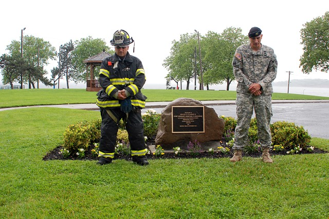 A U.S. Army Soldier and a New York City Fire Department firefighter stand solemnly near the stone that will remain as a permanent reminder of firefighter and U.S. Army National Guard Soldier Staff Sgt. Chris Engeldrum, for all who visit the Fort Hamilton, N.Y., Bluff. Engeldrum, 39, of the 69th Infantry Regiment New York Army National Guard, was killed when his vehicle hit an improvised explosive device while on patrol outside of Baghdad, Nov. 29, 2004.