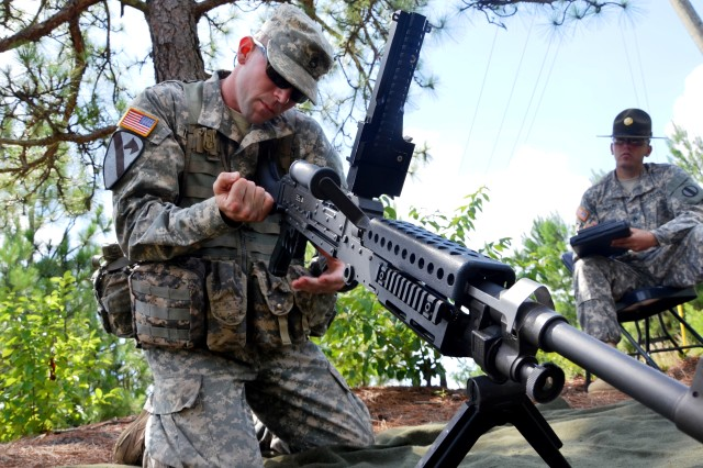 Staff Sgt. Steven Newman, assigned to the Maneuver Center of Excellence, Fort Benning, Ga., completes a functions check on a M-240B machine gun to ensure the weapon is operational during the 2013 Drill Sergeant of the Year competition July 16, 2013 at Fort Jackson, S.C. The competitors were required to complete the functions check in less than five minutes to test their knowledge.