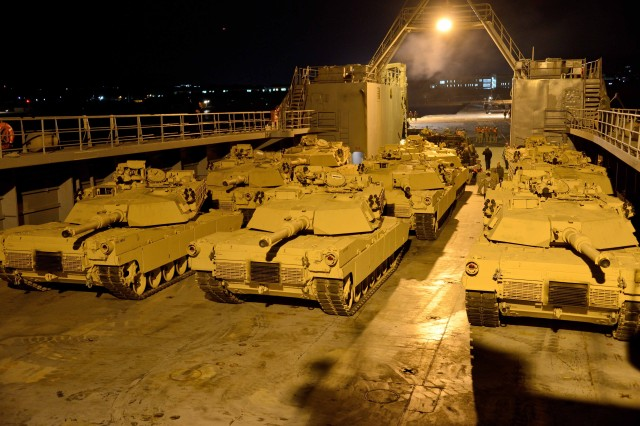 Secretary of the Army John McHugh met with 8th Theater Sustainment Command mariners aboard the LSV-4 at its home-dock on Joint Base Pearl Harbor-Hickam, Hawaii, July 16, 2013, to discuss these other Army watercraft capabilities. Pictured here, M1A1 Abrams tanks are staged for off-load on the deck of Army Logistics Support Vessel 4 as part of Combined Logistics Over the Shore 13, off the shore of Pohang, Republic of Korea, April 19, 2013.