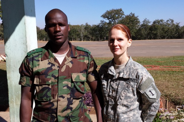 Second Lt. Jessica A. Morley, an environmental science and engineering officer, Charlie Company, 299th Brigade Support Battalion, 2nd Heavy Brigade Combat Team, 1st Infantry Division, poses with a Malawi Defense Force soldier during the Environmental Health and Field Sanitation military-to-military event June 19-21. During the exercise, 15 MDF soldiers learned how the U.S. Army conducts preventive medicine and field sanitation risk reduction strategies to ensure that soldiers remain as healthy as possible in a combat/field environment.
