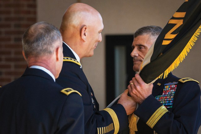 Army Chief of Staff Gen. Raymond T. Odierno, a U.S. Military Academy Class of 1976 graduate, presents Lt. Gen. Robert Caslen Jr. with the U.S. Military Academy colors during the superintendent change-of-command ceremony, July 17, 2013, in the Eisenhower Hall Ballroom at the U.S. Military Academy at West Point, N.Y. Caslen, a USMA Class of 1975 graduate, assumes command from Lt. Gen. David H. Huntoon Jr., and becomes the 59th superintendent of the academy.