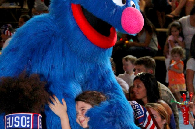 Grover makes one member of the crowd very happy by giving her a big furry hug.