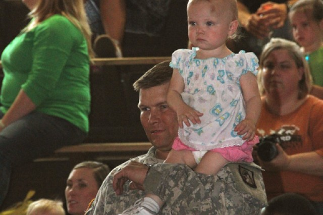 Father and daughter are completely mesmerized by the wonderful performance of the Sesame Street / USO Experience for Military Families.