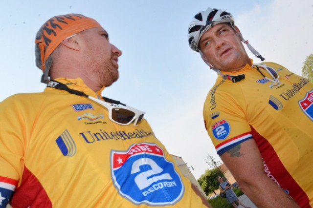 Two cyclists chat before hitting the road on the first leg of the Italy Challenge. Some 120 Soldiers, veterans, civilians and their supporters gathered on Caserma Ederle in Vicenza, Italy, July 11 to begin the first leg of a 700-kilometer Ride2Recovery bicycle trek through Northern Italy and France. The first day's ride, a 44-mile (70-kilometer) stretch, took the cyclists to Verona.