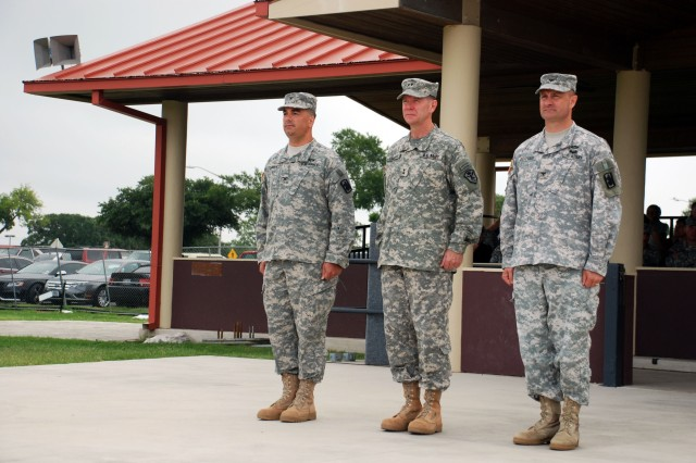 From left, Col. Timothy A. Chafos, incoming commander of the 470th Military Intelligence Brigade; Maj. Gen. Stephen Fogarty, commanding general of the Intelligence and Security Command; and Col. Pierre Gervais, outgoing commander of the brigade, stand at attention during part of the brigade's change of command ceremonies. The brigade conducted the ceremonies on MacArthur Field at Joint Base San Antonio-Fort Sam Houston July 17. (U.S. Army photo by Gregory Ripps, 470th Military Intelligence Brigade)