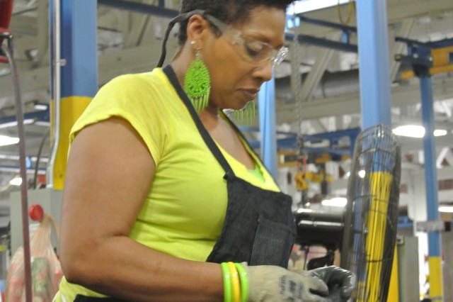 Leslie Johnson attaches connectors to a tube that will become part of an ammunition rack for a M1 Abrams tank in Anniston Army Depot's Nichols Industrial Complex.