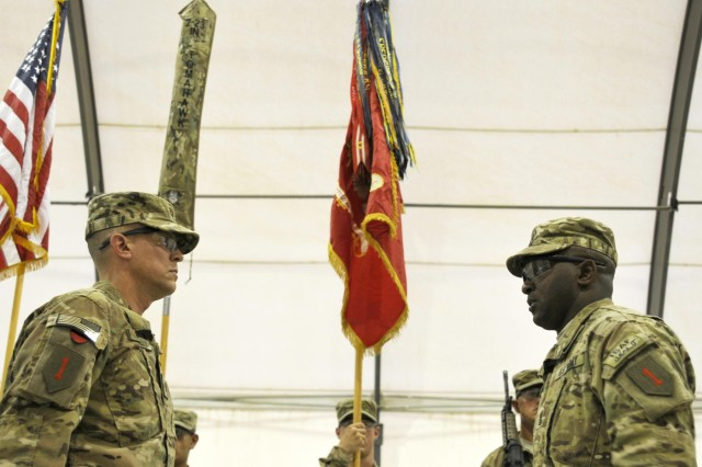 U.S. Army Lt. Col. Henry I. B. McNeilly and Command Sgt. Maj. Aaron White, the commander and senior enlisted member of 1st Battalion, 6th Field Artillery Regiment, complete the uncasing of the battalion colors in a transfer of authority ceremony July 13, 2013 at Forward Operating Base Spin Boldak, Kandahar province, Afghanistan. (U.S. Army photo by Staff Sgt. Shane Haman, 102nd Mobile Public Affairs Detachment.)