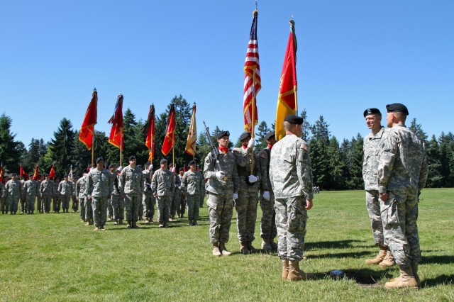 From right, Col. Ken Kamper, the outgoing 17th Fires Brigade commander, stands at the front of formation alongside Maj. Gen. Stephen Lanza, the 7th Infantry Division commanding general, and Col. Timothy Kehoe, the incoming 17th Fires Brigade commander, during a brigade change of command ceremony at Watkins Field, Joint Base Lewis-McChord, Wash., July 15, 2013. (U.S. Army photo by Spc. Nathan Goodall, 17th Fires Brigade Public Affairs)