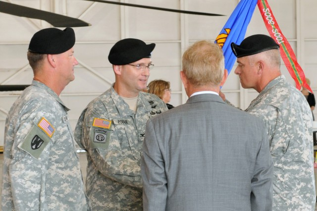 AMCOM Commander MG Lynn A. Collyar presents the CCAD flag to COL Billingsley Garner Pogue III as he assumes command of the depot, July 15. Mr. Bill Braddy, CCAD's Deputy Director of Production Operations and a civilian, lead the depot as Executive Director for the nearly three-month gap between commanders.