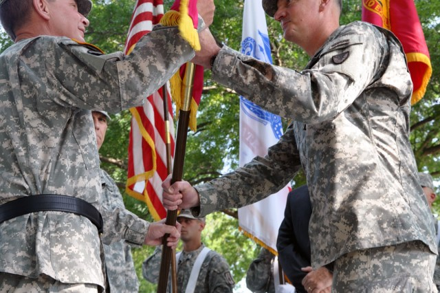 It is done...Col. Mark F. Migaleddi, right, hands the Arsenal's organizational colors to Maj. Gen. Michael J. Terry.