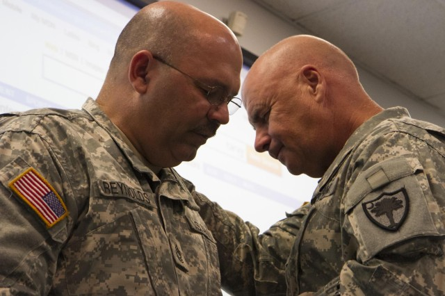 U.S. Army Master Sgt. Dennis Reynolds, left, state chaplain assistant, and Col. Steven Shugart, outgoing state chaplain, share a quiet moment during the passing of the stole ceremony at the adjutant general's office July 13, 2013, in Columbia, S.C.  (U.S. Army National Guard photo by Sgt. Erica Knight/Released)