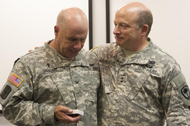 U.S. Army Maj. Gen. Robert E. Livingston Jr., the adjutant general of the South Carolina National Guard, talks to Col. Steven Shugart, outgoing state chaplain, during a ceremony at the adjutant general's office in Columbia, S.C., July 13, 2013. Livingston gave Shugart a memento honoring the South Carolina soldier's warrior spirit.  (U.S. Army National Guard photo by Sgt. Erica Knight/Released)