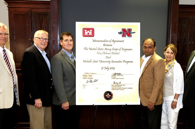 Members of the U.S. Army Corps of Engineers, New Orleans District, and Nicholls State University Representatives, stand alongside their newly signed Memorandum of Agreement, July 17, 2013.