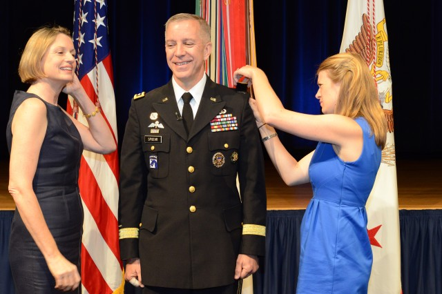 Maj. Gen. Thomas W. Spoehr is promoted to lieutenant general in a Pentagon ceremony, with his wife Cynthia (left) and daughter Catherine affixing the new rank to his uniform.