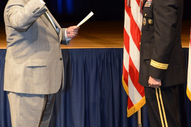 Under Secretary of the Army Joseph Westphal swears in newly promoted Lt. Gen. Thomas W. Spoehr, July 18, 2013.