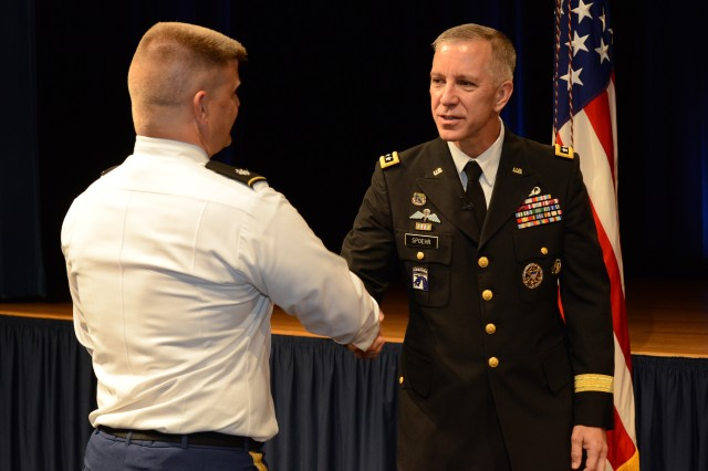 Lt. Gen. Thomas W. Spoehr greets a service member at his promotion ceremony at the Pentagon, July 18, 2013.