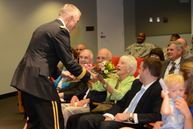 Lt. Gen. Thomas W. Spoehr presents his parents flowers during his promotion ceremony at the Pentagon, July 18, 2013.