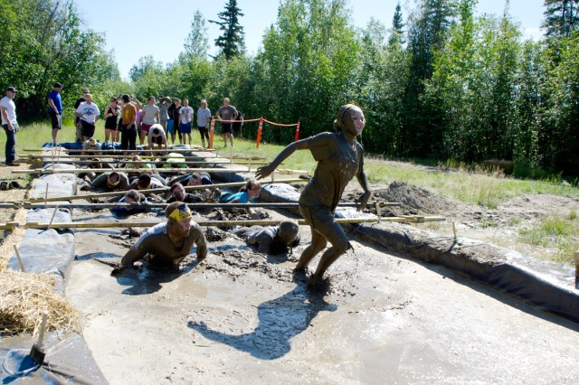 A runner leaves the mudpit during the 2nd annual Arctic Tough Mudders event July 13.