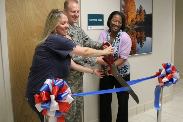 Angela Allin, registered nurse and certified lactation specialist, Col. Thomas S. Bundt, Kenner Army Health Clinic, commander, and Dr. Janet West-Brown Wilkerson Pediatric Clinic, chief cut the ribbon officially opening the clinic's lactation room. The room features two chairs, a sink, a diaper changing station and a refrigerator. Nursing and lactating mothers who are employees or beneficiaries of Kenner may use the room to breastfeed or pump breast milk.