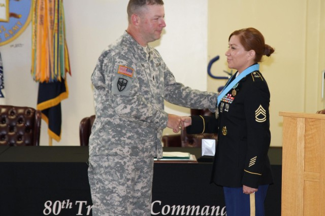 Command Sgt. Maj. James Wills, senior enlisted leader for the 80th Training Command (TASS), congratulated Sgt. 1st Class Rosemary Armijo during a Sergeant Audie Murphy Club induction ceremony held by the 80th TC (TASS) headquarters July 13.