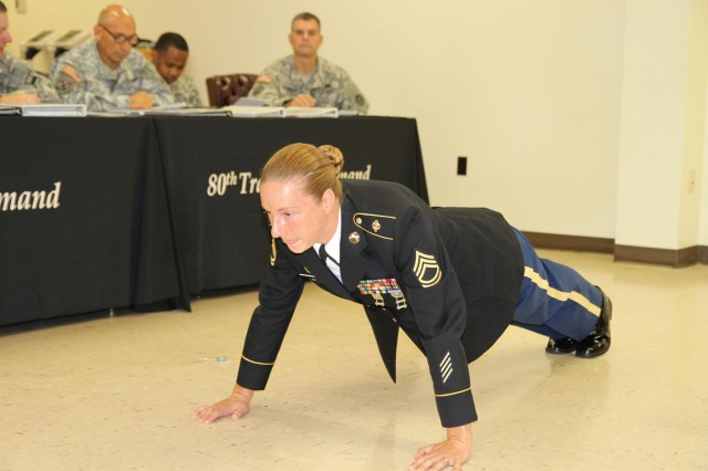 Sgt. 1st Class Jessica Lam performed 10 pushups while reciting the Sergeant Audie Murphy bio during the 80th Training Command (TASS) Sergeant Audie Muprhy Club board appearance held at the headquarters July 13, 2013.