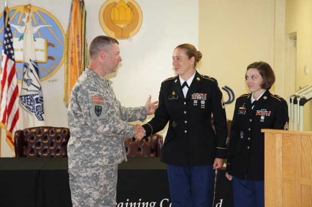 Command Sgt. Maj. James Wills, senior enlisted leader for the 80th Training Command (TASS), congratulates Sgt. 1st Class Jessica Lam and Staff Sgt. Kristina Fallis for their nomination into the Sergeant Audie Murphy Club. Both soldiers were selected after appearing before a Sergeant Audie Murphy Club board held by the 80th TC headquarters July 13.