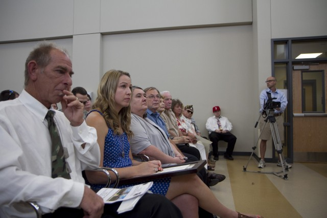 Family members of Sgt. Thomas J. (T.J.) Butler IV during the ceremony that memorialized the Armed Forces Reserve Center in Wilmington, N.C. after the son, husband, father and fourth T.J. Butler. on the far left, is Thomas J. Butler III. His grandosn, Thomas V is sitting with his mother, Holly Butler. Sgt. Butler was killed in Khost, Aghanistan on October 1, 2012 while deployed there with the 514th Military Police Company of the North Carolina Army National Guard.