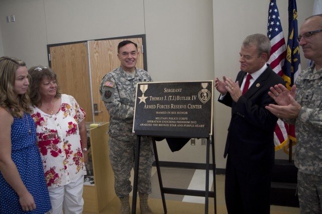 The plaque for the newly renamed Sgt. Thomas J. (T.J.) Butler IV Armed Forces Reserve Center is unveiled in Wilmington, N.C. on July 13. Assisting in the unveiling is, from left to right, Mrs. Holly Butler (widow), Mrs. Leslie Butler (mother), Maj. Gen. Gill Beck, commanding general of the 81st Regional Support Command, Congressman Mike McIntyre, 7th District, and Maj. Gen. Greg Lusk, the Adjutant General of the N.C. National Guard.