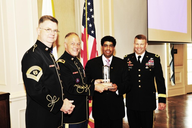 From left, The U.S. Army Band Command Sgt. Maj. Mitchell Spray, TUSAB Leader and Commander Col. Thomas Palmatier, AUSA George Washington Chapter President Todd Hunter and Joint Force Headquarters-National Capital Region and Military District of Washington Commander Maj. Gen. Jeffrey Buchanan pose with the Commander-in-Chief Award at the AUSA luncheon July 17.