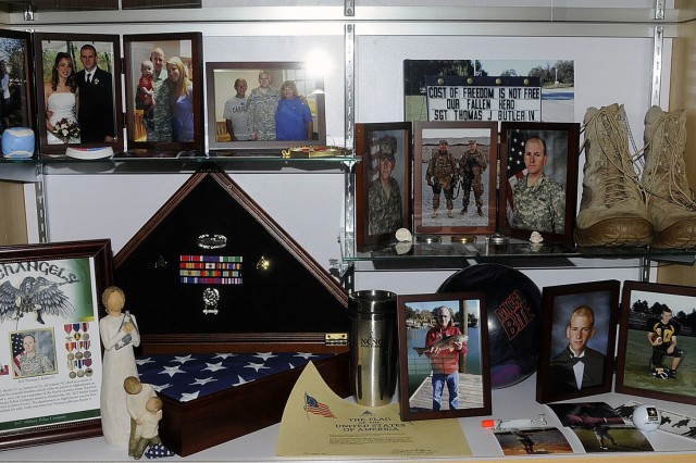 The display case containing various artifacts donated by the family of Sgt. Thomas J. Butler for the ceremony dedicating and renaming the Wilmington Armed Forces Reserve center in his honor. Butler was killed in action in October 1, 2012 in Khost City, Afghanistan while deployed with the 514th Military Police Company.