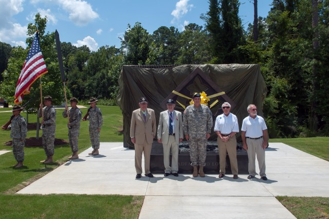 Members of the National 4th Infantry Division Association and Army Chief of Staff Gen. Ray Odierno stand at attention prior to unveiling the 4th Infantry Division monument in Fort Benning, Ga. July 18, 2013. (U.S. Army photo by Staff Sgt. Teddy Wade/ Released)
