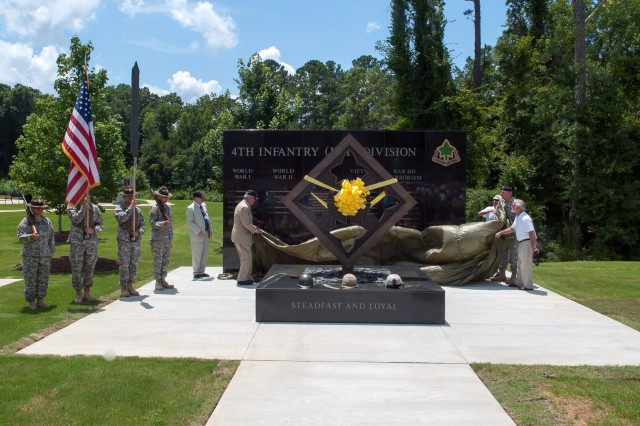 U.S. Army Chief of Staff Gen. Ray Odierno and members of the National 4th Infantry Division Association unveil the 4th Infantry Division monument in Fort Benning, Ga. July 18, 2013. (U.S. Army photo by Staff Sgt. Teddy Wade/ Released)