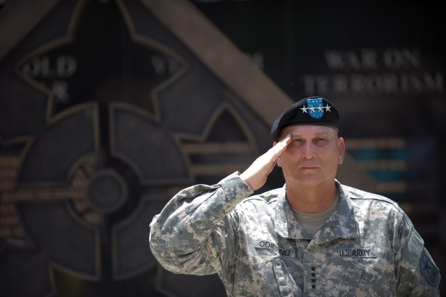 U.S. Army Chief of Staff Gen. Ray Odierno salutes during the 4th Infantry Division monument dedication in Fort Benning, Ga. July 18, 2013. (U.S. Army photo by Staff Sgt. Teddy Wade/ Released)