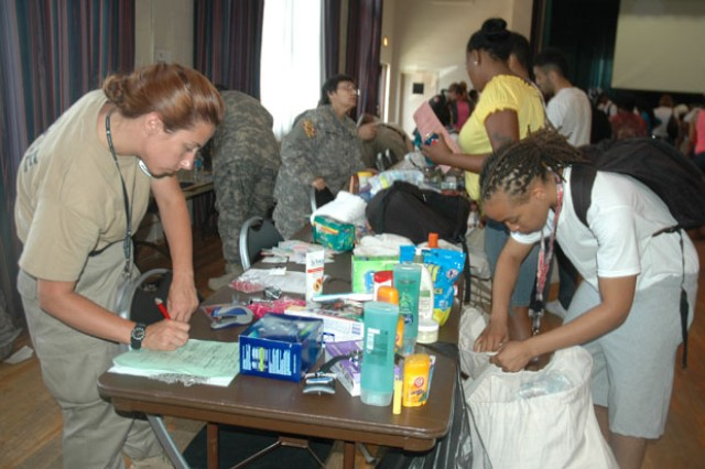 (From left) Cadre Cpl.  Drisana Lynch checks Candidate Diamond Newman's personal items during the MDNG Freestate ChalleNGe Academy's in-processing of Class #41 candidates at the APG South (Edgewood) recreation center July 14.