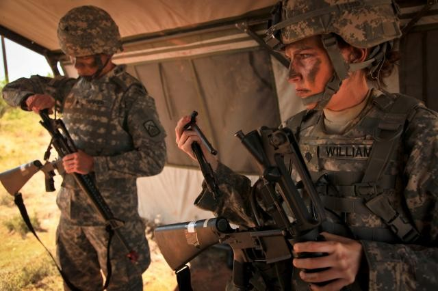 Sgt. Phillip Barker (left), 160th Signal Brigade, and Spc. Brittany Williams, 7th Signal Command (Theater), prepare to reassemble their rifles for the react to contact lane, during the Non-commissioned Officer and Soldier of the Year competition. Last month the Army announced its plan to integrate women into combat roles, opening positions within 27 brigade combat teams, which include nine National Guard brigade combat teams.